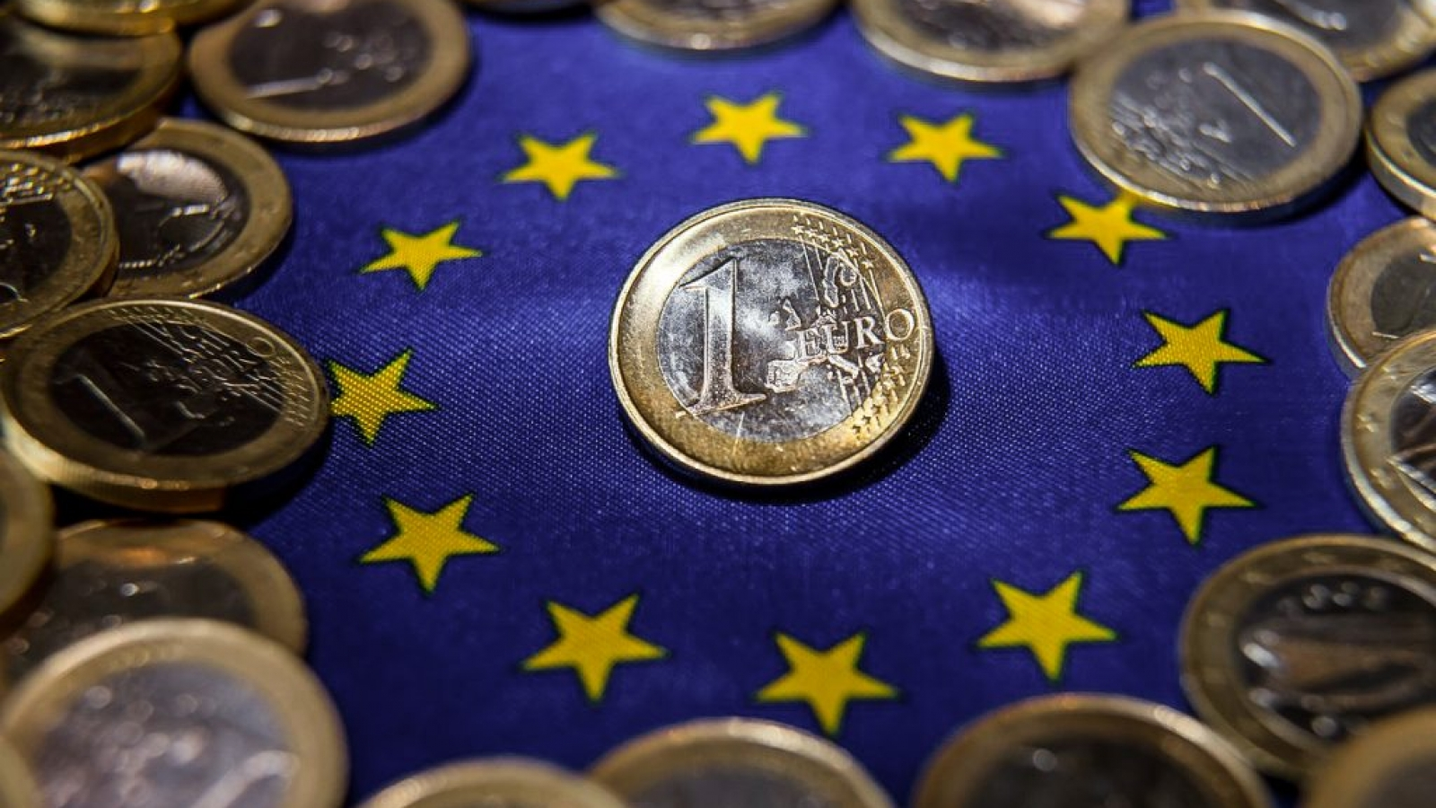 (FILES) This file photo taken on August 25, 2014 shows one-euro coins in Lille, northern France. The euro, used by nearly 340 million people each day, celebrates its 15th birthday on Sunday, January 1, 2017., Image: 309689837, License: Rights-managed, Restrictions: , Model Release: no, Credit line: Profimedia, AFP